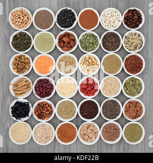 Dried diet super food with grains, cereals, legumes, nutritional supplement powders, fruit, seeds, nuts and herbs - Stock Photo