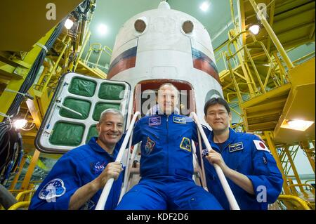 NASA International Space Station Expedition 52 backup crew members (L-R) American astronaut Mark Vande Hei, Russian - Stock Photo
