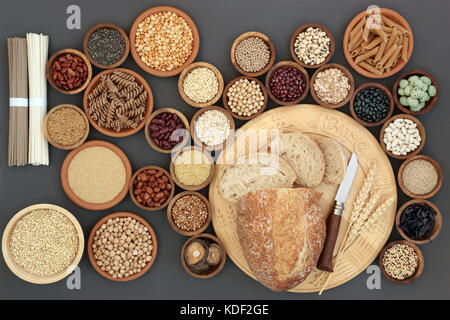 Dried macrobiotic diet health food concept with sour dough bread, nobu and soba noodles, legumes, seaweed, grains, - Stock Photo