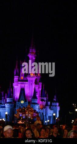Cinderella's Castle lit up at night time in Magic Kingdom, Disney World, Florida, USA - Stock Photo
