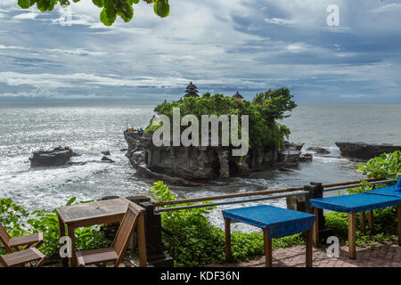 Dining with a view to Tanah Lot temple, Bali, Indonesia - Stock Photo