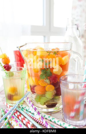 Homemade fruit punch with colorful fruits and mint - Stock Photo