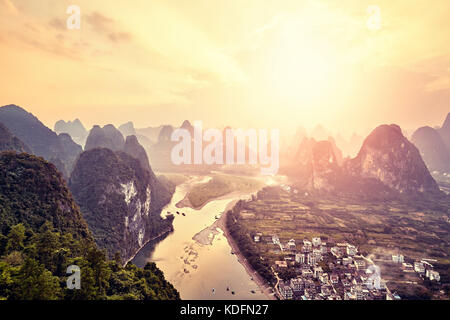 Lijiang River at sunset seen from Xingping village viewpoint, located 63 km from Guilin and 25 km from Yangshuo, - Stock Photo