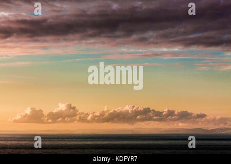 A stormy sunset over the Bristol Channel taken from the north Devon coast near Lynmouth, England, UK - Stock Photo