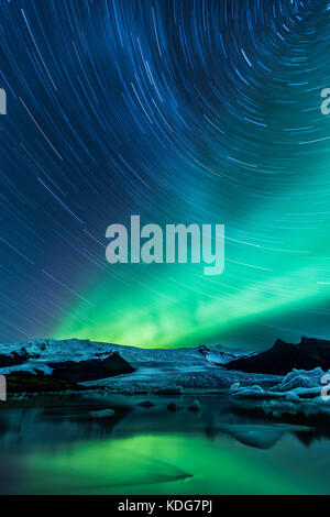 Long Exposure From Fjallsarlon Glacial Lagoon with Star trail and Northern Lights (Aurora Borealis), Iceland - Stock Photo