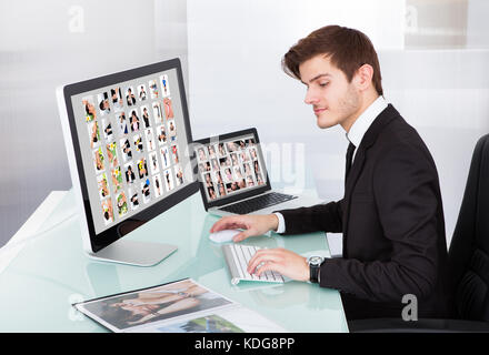 Portrait Of A Professional Businessman Editing Images In Office - Stock Photo