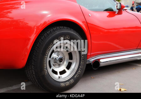 Meeting of classic american cars. Rear wheel of red Chevrolet Corvette C3 Stingray (Made from 1968 to 1982). Yokohama - Stock Photo