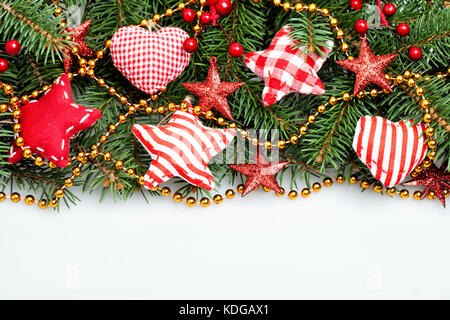 Christmas Decorations Border On White Background Xmas Tree Twig Red Stars And Gold Garland