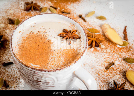 Traditional indian masala chai tea with spices - cinnamon, cardamom, anise, white background. Copy space - Stock Photo