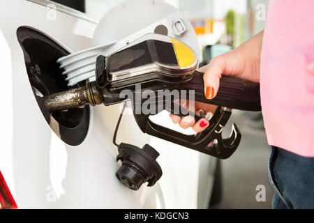 Male Hand Refilling The Car With Fuel On A Filling Station - Stock Photo
