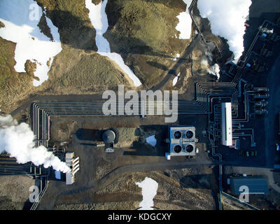 Aerial photograph of Hellisheidi geothermal powerplant in iceland, shot in springtime with snow on the ground close - Stock Photo