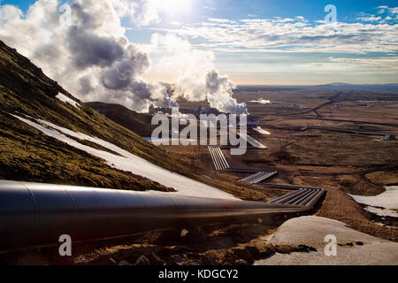 Hellisheidi geothermal powerplant in iceland, shot in evening sun in spring. Pipes leading to the power plant in - Stock Photo