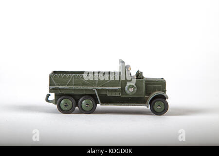 Vintage toy die cast army truck made by Dinky toys  in England in the 1930´s. isolated and shot on white - Stock Photo