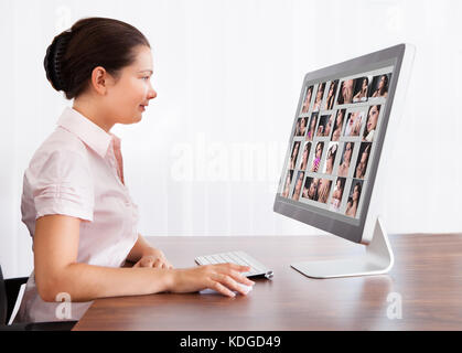 Happy Professional Designer Woman Editing Images In Office - Stock Photo
