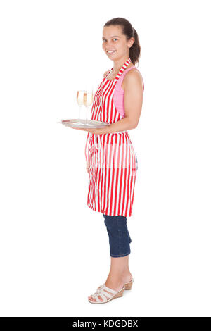 Young Waitress Carrying A Tray With Champagne Glasses on white background - Stock Photo
