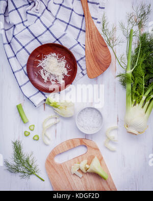 Fresh organic fennel bulbs for culinary purposes on wooden background. - Stock Photo