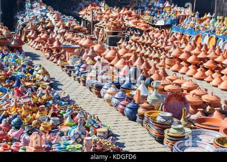 Traditional ceramic tagins for sale in city market in Meknes. Morocco - Stock Photo