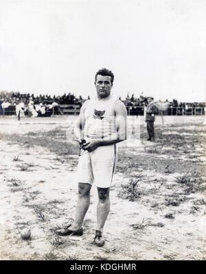 John Jesus Flannigan of the Greater New York Irish Athletic Association, winner of the 16 pound hammer throw at - Stock Photo