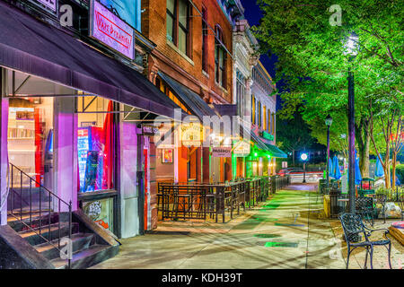 ATHENS, GEORGIA - AUGUST 13, 2017: Shops and bars along College Avenue in downtown Athens at night. - Stock Photo