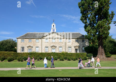 Visitors Walk Past the Stable Block (1735) at Compton Verney House, Kineton, Warwickshire, England - Stock Photo