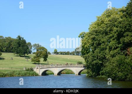 Bridge, Lake & Parkland Designed by Capability Brown at Compton Verney House, Kineton, Warwickshire, England - Stock Photo