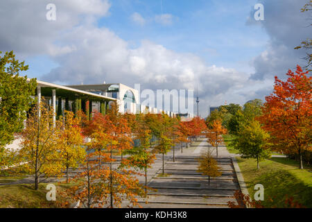 Colorful trees on a sunny day in Berlin, government district during autumn - Stock Photo