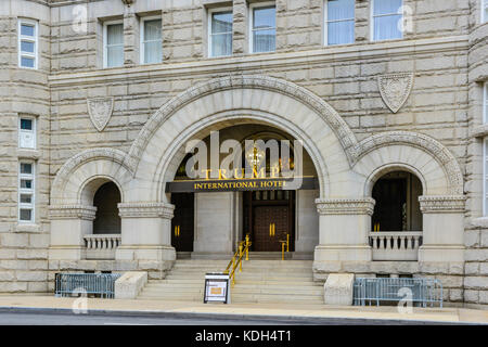 The golden TRUMP International Hotel sign in front of the renovated Old Post Office Building on Pennsylvania Avenue - Stock Photo