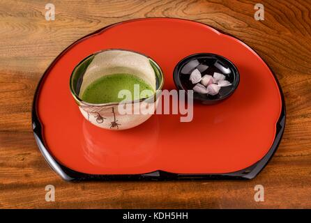 Japanese traditional green tea served with wagashi confectionery treats. - Stock Photo