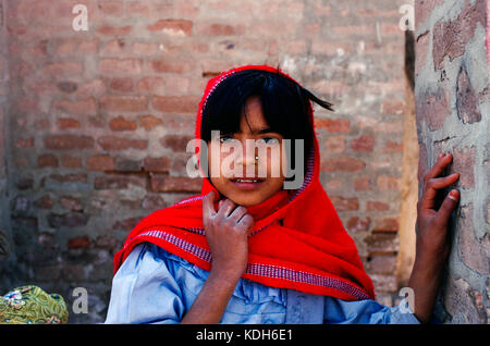 A young girl returning from school in Mari village, Kalabach, Pakistan, 1990. - Stock Photo
