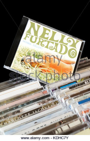 Whoa Nelly , Nelly Furtado CD pulled out from among rows of other CD's, Dorset, England - Stock Photo
