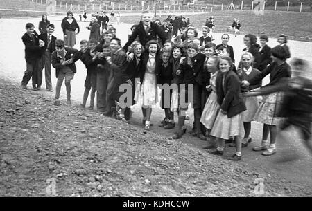 1960s, historical, in this picture we see a group of English secondary school children, boys - some wearing shorts - Stock Photo