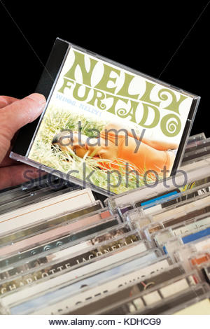 Whoa Nelly , Nelly Furtado CD being chosen from among rows of other CD's Dorset, England - Stock Photo