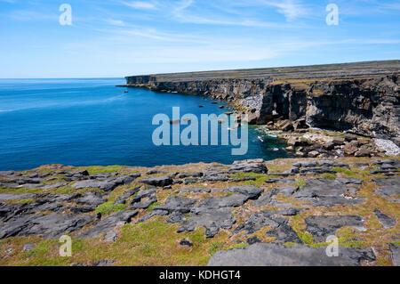 High cliffs at Inishmore Island near ruins of Dun Duchathair (Black Fort), Aran Islands, County Kerry, Ireland - Stock Photo