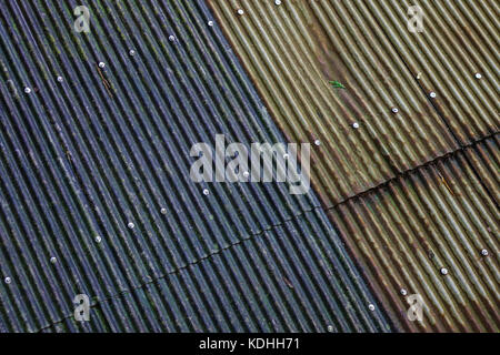 Old roofed houses made of galvanized iron in an old village. - Stock Photo