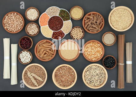Healthy dried macrobiotic food with soba and udon noodles, pulses, cereals, whole wheat pasta, seeds and cereals - Stock Photo