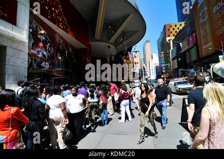 Visitors waiting to enter the Madame Tussauds wax museum in Times Square in Manhattan, New York. - Stock Photo
