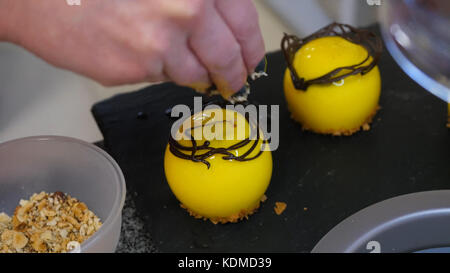Preparation handmade chocolate candies, close up. confectionery factory. production of confectionery. pastries, - Stock Photo