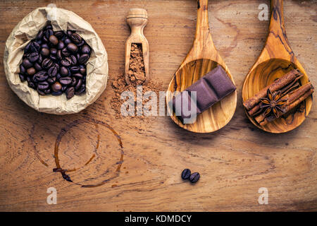 Coffee background and menu design. Ingredients for latte coffee . Roasted coffee beans in paper bag  ,chocolate - Stock Photo
