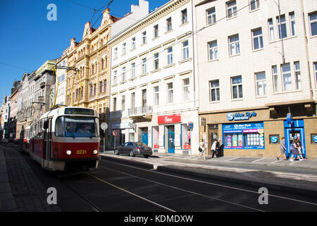 Travelers people walking beside road and tramcar running on Jindrisska road go to Henry's Bell Tower at new town - Stock Photo