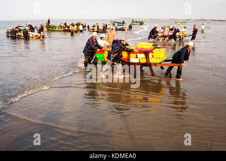 People's Daily life, fishing village with a lot of fish in fishing basket at traditional fish market on the Long - Stock Photo