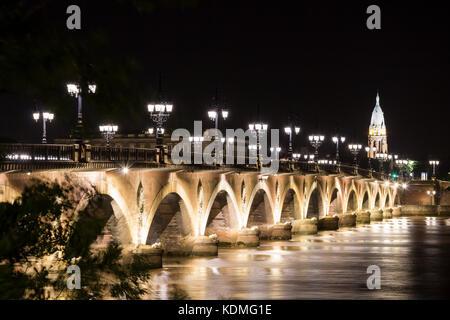 Pont de Pierre (Stone Bridge) at night, Bordeaux, France - Stock Photo