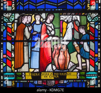 LONDON, GREAT BRITAIN - SEPTEMBER 16, 2017: The stained glass of he Wedding at Cana in church St Etheldreda by Charles - Stock Photo