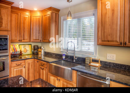 Stainless steel appliances in a modern, upscale kitchen in Vermont, USA. - Stock Photo
