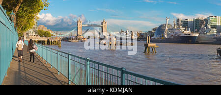 London - The promenade with the Tower bridge and the riverside in evening light. - Stock Photo