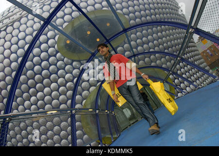 Shoppers leave Selfridges store in Birmingham laden with purchases, 2003. - Stock Photo