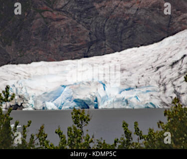Closeup of Mendenhall glacier ice as it touches into Mendenhall lake in Juneau, Alaska - Stock Photo