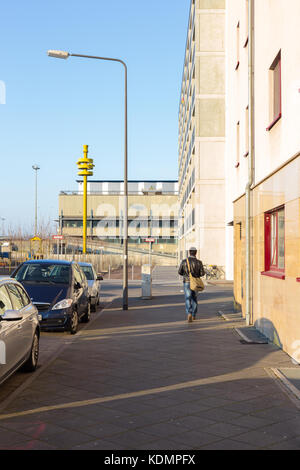 Man walking on the street of Frankfurt in the morning time - Stock Photo