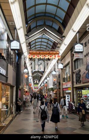 Kyoto, Japan - May 18, 2017: Pedestrians walking in the Shin Kyogoku Shopping Arcade - Stock Photo