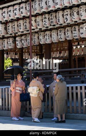 Kyoto, Japan - May 19, 2017: Traditional dressed women in kimono in front of the Yasaka jinja shrine - Stock Photo