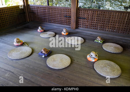 Kyoto, Japan - May 19, 2017: Room with traditional zen buddhist wooden fish gongs, Mokugyo and pillows to perform - Stock Photo